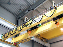 An Overhead Crane equiped with a Conductix-Wampfler C-Rail Cable Festoon System